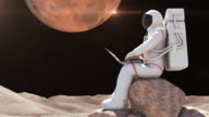 Astronaut Sitting On A Rock And Working With Computer