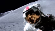 Astronaut wearing new A7LB spacesuit on moon surface during Apollo 15 mission / reflection seen in visor of spacesuit / astronaut collecting samples...