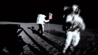 Astronauts Alan Shepard and Edgar Mitchell planting American flag on the Moon surface during Apollo 14 mission on February 05 1971