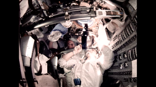 / astronauts Charles Conrad Alan Bean and Richard Gordon living inside Command Module goofing around and taking pictures out the window Apollo 12...