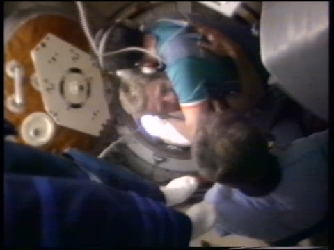 US astronauts enter MIR from space shuttle Atlantis hug Russian cosmonauts / STS86