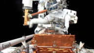 Astronauts floating outside Hubble making repairs on STS125 mission 4 to repair the telescope / astronauts make space walk / astronaut John Grunsfeld...
