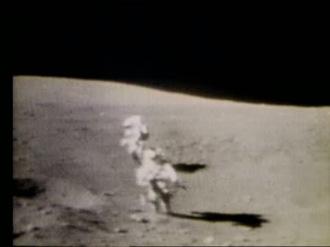 2 astronauts running toward camera on Moon / Apollo 16