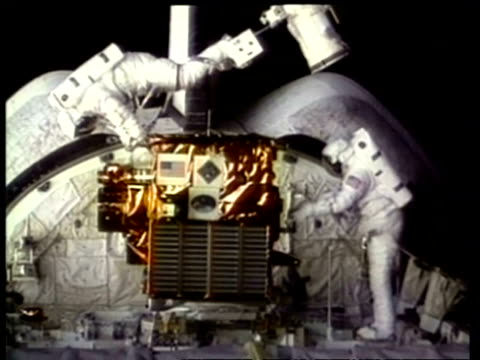 MS Astronauts working on Spartan satellite, NASA