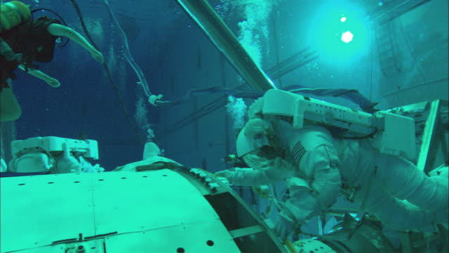 MS TS Astronauts working underwater on mock up of International Space Station in Neutral Buoyancy Lab, Houston, Texas, USA