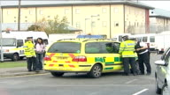 Asylum seekers riot at Harmondsworth detention centre general views police presence Traffic along past line of Serco prison vans parked at side of...
