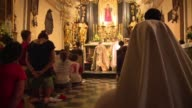 At a church in Krakow people gather for a vigil after a French priest was killed in an attack Tuesday in northern town of SaintEtienneduRouvray...