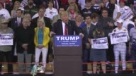 At a rally in Orlando US Republican presidential candidate Donald Trump tells a story about General Pershing's alleged execution using bullets dipped...