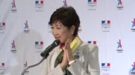 At a reception at the French embassy in Japan Tokyo's Governor Yuriko Koike congratulates Paris on being chosen as the host city for the 2024 Olympics