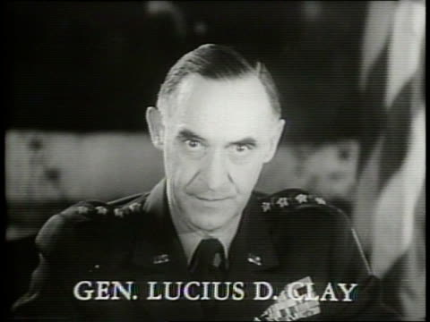 At American headquarters General Lucius Clay sits at a table and explains the policy on the Western German Republic / General Clay says that a West...