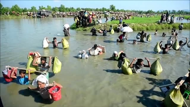 At least 10 people drowned and dozens more are missing after a boat packed with Rohingya fleeing to Bangladesh sank as another 12000 people joined a...
