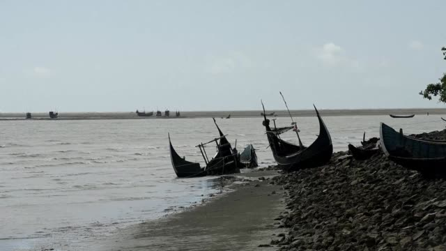 At least 12 Rohingya refugees most of them children drowned and scores more are missing after their overloaded boat capsized in the latest tragedy to...