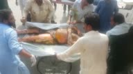 At least 123 people are killed and scores injured in a fire that broke out after an oil tanker overturned in central Pakistan and crowds rushed to...