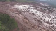 At least 17 people are killed and a village destroyed after two dams burst in southeastern Brazil