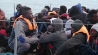At least 20 boats carrying thousands of migrants on their way to Italy are spotted off the coast of the western city of Sabratha the Libyan navy says