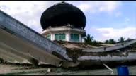 At least 25 people die and hundreds are injured after a strong earthquake struck off Aceh province on Indonesia's Sumatra island