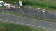 At least 4 people killed in crash on M5 AIR VIEW Crash scene including debris on motorway and lorry and car in ditch Wreckage of car on motorway AIR...