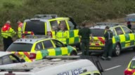 At least 4 people killed in crash on M5 Fire engines and police officers at scene Paramedics and ambulance cars Wide shot of police officer along and...
