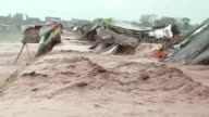 At least 53 people are killed and 60 injured after heavy rain across northwest Pakistan and areas of Kashmir cause landslides and the roofs of dozens...