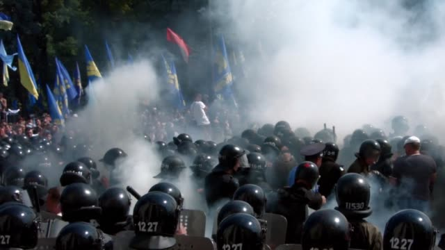 At least 90 people mainly police were wounded in fierce clashes outside the Ukrainian parliament on Monday as lawmakers gave initial backing to...