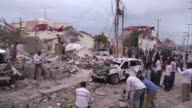 At least six people were killed Sunday when a suspected car bomb exploded at a heavily guarded hotel in the Somali capital Mogadishu housing...