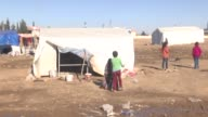 At least thirty Syrian families prepare themselves to the conditions of harsh winter among their makeshift tents at refugee camp in the Akcakale...