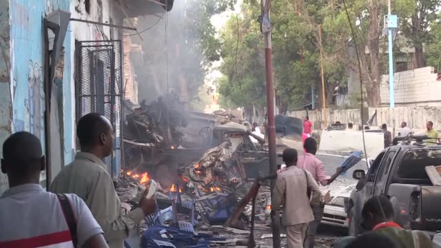 At least three people were killed in twin car bombings in the Somali capital on Saturday that were claimed by Shabaab Islamists police and medics said