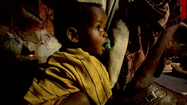 at refugee camp Refugee children and man inside shelter on July 30 2011 in Dadaab Kenya