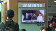 At Seoul station South Koreas watch the news after North Korean leader Kim JongUn said US President Donald Trump is mentally deranged and will pay...