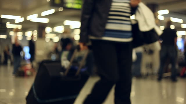 At the airport - people with luggage