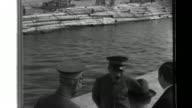 At the Port of Tokyo Prime Minister Hideki Tojo rewards Transportation Commanders Lieutenant Jiro Yamaguchi and Lieutenant Tatsutoshi Tomii after...