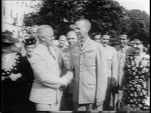 At the White House President Harry S Truman bestows General Jonathan Wainwright with the Congressional Medal of Honor / photographers snap pictures...