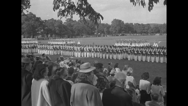 [6/3/46] At West Point NY graduating Cadets marching in formation on parade ground at the United States Military Academy / shot from behind crowd in...