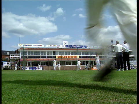 Atherton prepares for test ENGLAND Yorkshire Headingley Michael Atherton holds ball in training PAN RL GV Cricket ground as players run in pack CMS...