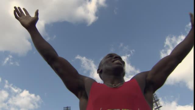 LA MS Athlete celebrating after winning race / Sheffield, England, UK