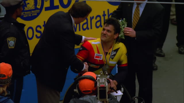 Athlete is awarded for winning men's wheelchair race at Boston Marathon; 1997 Available in HD.