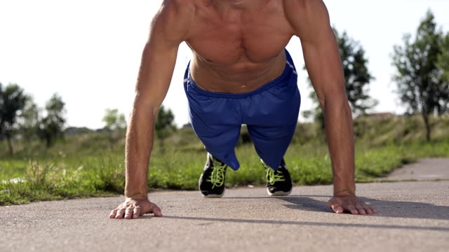 Athlete man doing clapping push ups