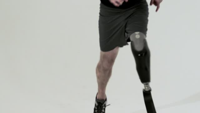 Athlete running with prosthetic leg