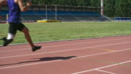 Athlete with prosthetic leg running on track