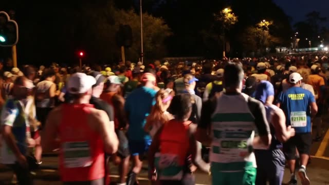 Athletes compete in the Two Oceans Ultra Marathon in Cape Town South Africa on April 15 2017