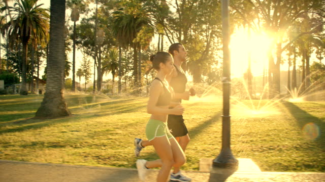 Athletic Couple Jogging Slow-Motion