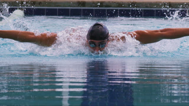 Athletic swimmer in a race