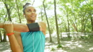 Athletic woman stretching before off road running in park