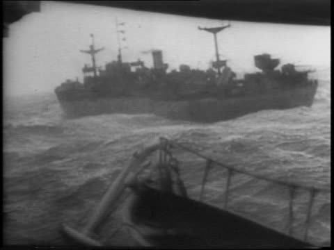 Atlantic convoy to a strategic front freighters supply ships / it is guarded by subkillers and the US Coast Guard / Guardsmen resting on deck of...