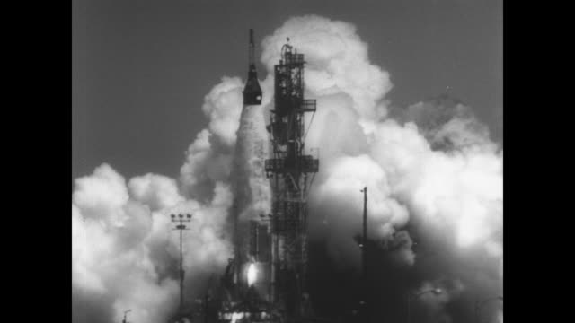 Atlas missile on launch pad at Cape Canaveral in last test before man is launched into space / CU astronaut capsule in rocket's nose / rocket leaves...