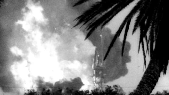 AtlasCentaur rocket explodes at Cape Kennedy / rocket on launch pad / rocket takes off and immediately falls back / huge explosion / large fire among...