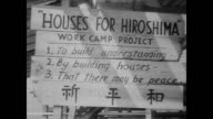/ Atomic Bomb Casualty Commission inspects rubble in Hiroshima / Peace Tower under construction / man with scars smiles at camera / scenes of...