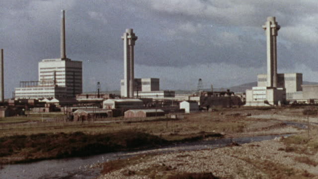 1957 MONTAGE Atomic power reactors at Calder Hall and Windscale, with technicians operating the facility / Cumbria, United Kingdom