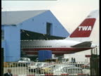 Atomic trigger trial ENGLAND London Heathrow Airport TGV Airport with radar scanner turning LMS Top of TWA aeroplane tail along PAN LR LMS Tail end...