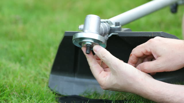 Attaching blade of portable hand-held powered brush-cutter.